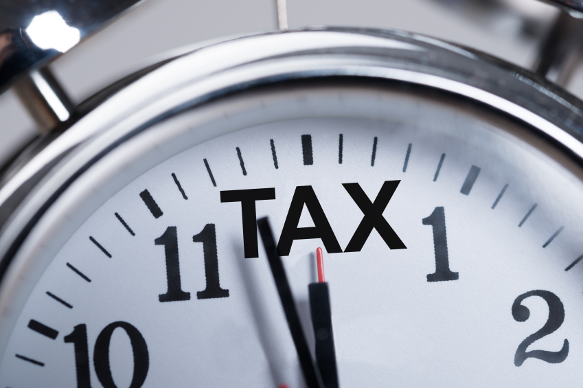 Alarmclock Showing Arrival Of Tax Time